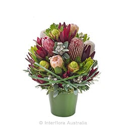 BUSH BLOOMS Arrangement of mixed wild flowers in ceramic container AUS 816