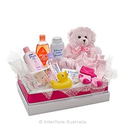 CUDDLES FOR HER Teddy bear with a selection of baby care goods AUS 745