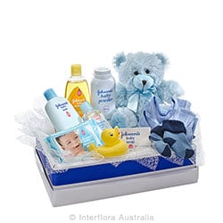 CUDDLES FOR HIM Teddy bear with a selection of baby care goods AUS 746